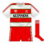 1984-86 Away: First away kit, essentially the same as the home but with the green and red parts swapping places.